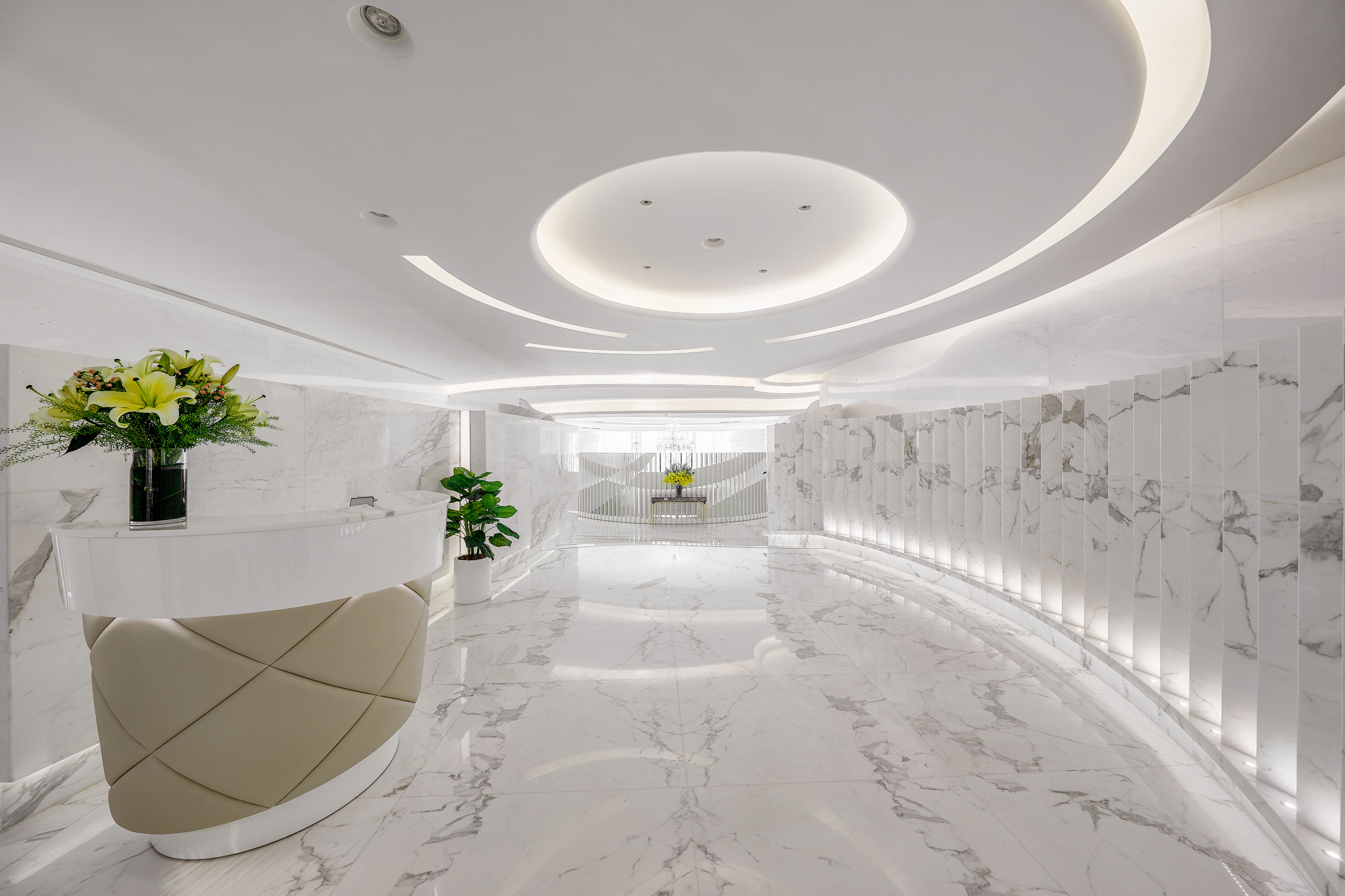 LE PAN is a palace of white marble with playful curves and cream, grey and gold accents.