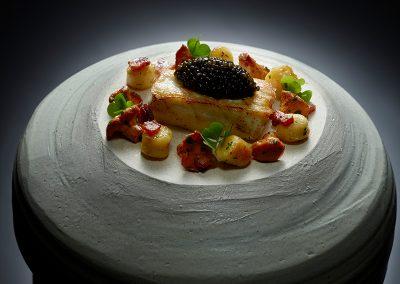 Amur Oscietra caviar, wild turbot, Champagne sauce, smoked bacon, Parisian gnocchi, Savoy cabbage